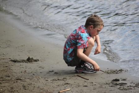 young boy at beach summer on vancouver island