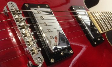 Red electric guitar close up